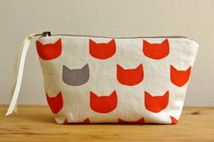 Ginger cats grey pouch by doabit as featured in the Etsy Summer Shopping Guide. Check out the other selections + the discount code here // http://etsy.me/UOErAs