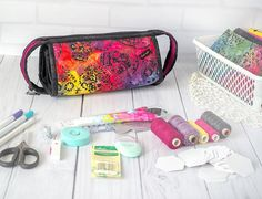 Bright sculls sew together bag with multiple pouches and zippered pockets it can be used for crafts- sewing, quilting, embroidery. And you can use how cosmetic organizer for travel. A large zipper pouch to keep you organized in your home or to accompany you when you travel. It has three zippered sections and three open sections and outer zipper continues all the way around the bag to form a handle. A very handy bag to carry all kinds of items. Great project bag for travel!