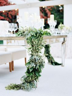 meadowood; meadowood wedding; napa wedding; napa valley wedding; vineyard wedding; northern california wedding; california wedding; britt chudleigh; a savvy event; nancy liu chin; outdoor wedding; outdoor reception; fabric roof; chandeliers; wooden chairs with white upholstery; white and green florals; table garlands of greenery and florals; mirrored tables
