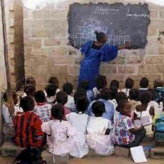 This is a picture of a school in Angola. This school is made possible from the Angola School Project. They take in orphans and give them the chance of earning an education.