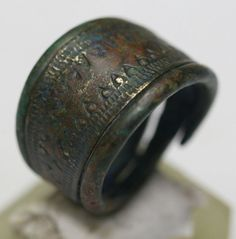 Truly beautiful Bronze Viking finger ring. Spiral type with the typical Viking decoration. (see spiral rings, second row, left on the plate with grave finds). Typical Viking Style. Dating: 9th/10th century. Origin: Scandinavia/Baltic Sea Coast Size: largest width strap 16 mm, diameter 18 mm - weight 6.8 grams. Condition: Very good, showing the usual age signs. Provenance. The supplier warrants that he has obtained this item in a legal manner. Originating from own collection built...