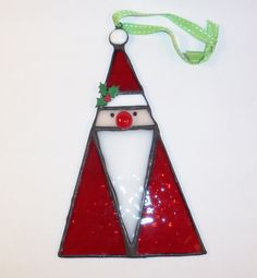 This jolly folk art stained glass Santa ornament measures 7.25 inches tall X4.5 inches wide. #pendant