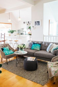 """A grey sofa works so well with bold colours and is a practical colour when you have young kids,"" says Kylie, who has brightened up the neutral living area with bold cushions from [Pillow Talk](http://www.pillowtalk.com.au/