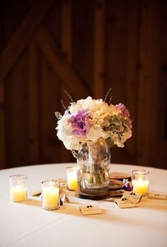 Hydrangea Mason Jar Centerpiece - From sweet antique dinnerware for a vintage wedding to lush floral chandeliers at an enchanted tented affair, here are some of our favorite details from recent real weddings. Mason Jar Centerpieces, Fall Wedding Bouquets, Rustic Wedding Centerpieces, Diy Wedding Decorations, Mason Jars, Hydrangea Centerpieces, Wedding Ideas, Wedding 2015, Teal Wedding Invitations