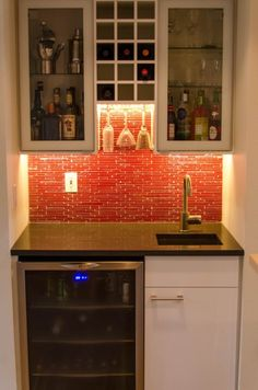 Wet+Bar+Cabinets+with+Sink | This little wet bar area is oh-so-cool. The under cabinet LED lights ...