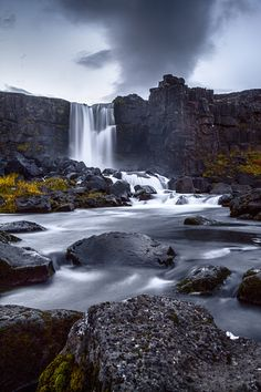 Öxarárfoss is a waterfall in Þingvellir National Park, Iceland. It flows from the river Öxará over the Almannagjá. The pool at the base of the waterfall is filled with rocks and is often very icy in winter.
