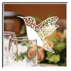 bird placecard...links to use of birds in final invite design. could have little trees in the bird detailing?