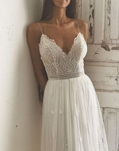 Boho lace | wedding dress | deep neckline | open back | thin straps | flowing skirt | Manuela by FLORA