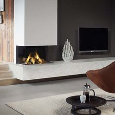 This is a collection of fireplace ideas we've collected. There are many unique and modern fireplace ideas that use easy-to-get materials such as ceramics, stones and bricks. Let's make your room more complete now. Modern Fireplace, Fireplace Design, Fireplace Mantle, Interior Exterior, Interior Design, Home And Living, Living Room, Fireplace Inserts, Gas Fires