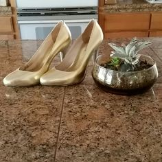 Gold MK Heels Gently used / in good condition. Great for a night out or formal event!  There are minute scratched as shown. Michael Kors Shoes Heels