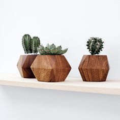 This planter is a real gem–paired with a tiny cactus or air plant it makes the perfect gift. Its geometric form featuring the rich Mugavu wood grain makes it a sculptural work of art for desk or shelf styling. Brilliantly hand carved from a single block of wood by master artisans, the craftsmanship behind this piece is stunning. Each piece is hand carved by a group of fifteen seasoned woodworkers in the Nakawa region, made exclusively in a fair trade environment. In the spirit of sustainabil...