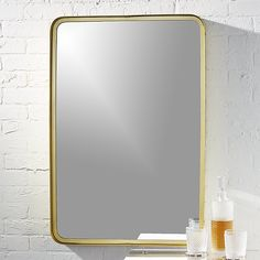 """Shop 24. 5""""x36"""" croft brass wall mirror.   Perfect for making a big statement, brass rectangle frame encloses inset mirror adding depth, dimension and reflecting a warm glow.  We love it in the entry, bath, bedroom or lined in the hall."""
