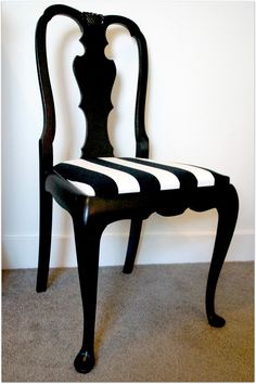 These classic vintage chairs have been freshly finished in satin black.  The newly reupholstered pop ups seats have a modern yet classic French style black and white thick stripe upholstery fabric, perfect for most decors.