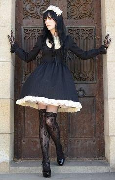 Classic #Gothic Lolita fashion with full skirt.