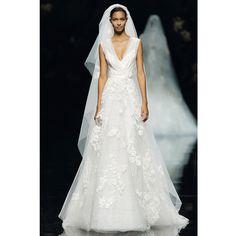 "Brides.com: Elie Saab - Spring 2013 ""Simone"" sleeveless lace A-line wedding dress with a sheer v-neckline and beaded applique details, Elie Saab  See more Elie Saab wedding dresses in our gallery.Photo: Courtesy of Elie Saab"