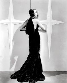 Kitty Carlisle in the film Here is My Heart from 1934. The gown was designed by Travis Banton. http://www.silverscreenmodiste.com/2013/07/back-in-style.html