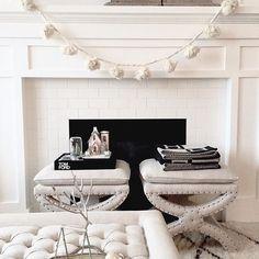 white fireplace + pompoms
