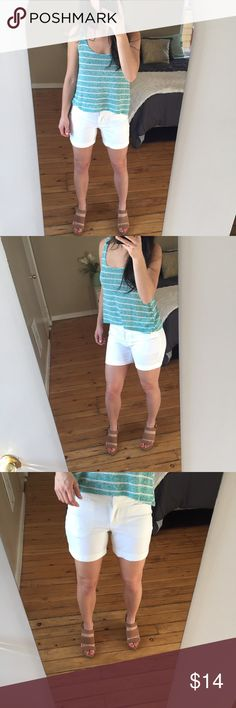 """White Shorts by Apt. 9, Size 2, NWT Brand new with tags super cute mid rise shorts. Straight through hip and thigh and ends at mid thigh.  Shorts are lined well so as not to be see-through.   Smooth look and feel. Green Nollie top also available in my closet!  Measurements: 5"""" inseam 13.5"""" from top of shorts to bottom of cuff  Materials: 98% cotton  2% spandex  Tags: Kohl's, summer shorts, summer wear, spring break, 4th of july Apt. 9 Shorts"""