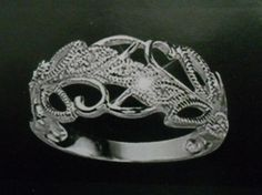 'Sterling Silver Genuine Diamond' is going up for auction at  3pm Wed, Sep 12 with a starting bid of $25.