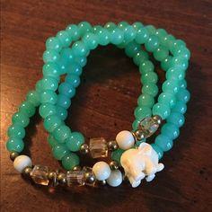 Green beaded elephant bracelet/necklace Turquoise beads with ivory colored elephant. Can be worn as a bracelet or necklace. Stretchy string. Never worn Jewelry