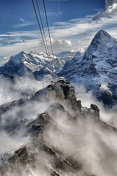 Switzerland - The Schilthorn. I rode the cable car to the top of the Schilthorn for lunch at the revolving restaurant. Unforgettable.