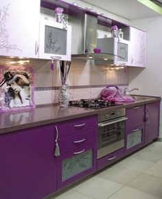 I never would have thought of a purple kitchen, but it's really beautiful. I think it would wear on me after awhile, though.