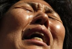 Liu cries during a gathering outside the Malaysian embassy in Beijing