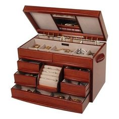 """Empress Mele and Co. Walnut Finish Jewelry Box by Universal Lighting and Decor. $175.00. cocoa suede interior fabric lining. Six drawers, one double drawer in middle, one ring drawer, one with four equal sections.. Size is 16 1/2"""" x 9 1/2"""" x 11 1/8"""". 7 divided sections for storage of earrings, rings, bracelets, & more.. Empress Mele and Co. jewelry box is a highly efficient storage container for all of your jewelry. It features seven divided sections on to..."""