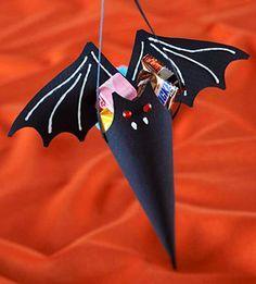 Paper bat cones hold Halloween treats. #Treats #Favors #Bat
