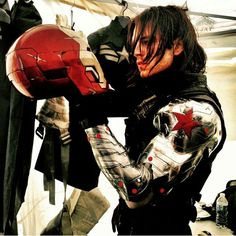 Sebastian Stan having a Hamlet moment with Iron Man's helmet while filming CATWS back in 2013.