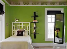 Black, white & green. Great wall color, and love the geometric headboard.
