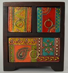 Hand painted in India, made from mango wood.