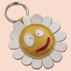 This cute little daisy flower keychain is completely made of 100% natural leather. Daisy is filled with cotton wool to get 3D look and soft touch. Dimensions of the keychain are 6,5 x 6,5 cm (2.56 x 2.56 in).