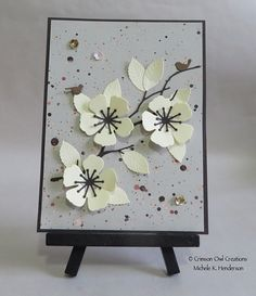 handmade card ... Asian feel ... die cut blossoms in vanilla and black ... artsy splatters on the background ...