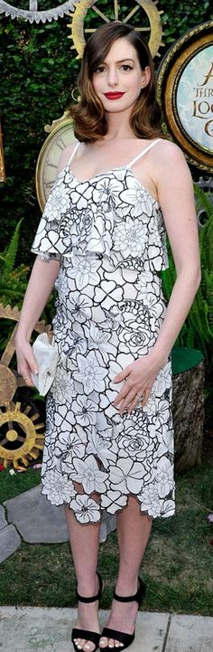 Anne Hathaway: Dress – Disaya  Shoes – Paul Andrew  Jewelry – James Banks Designs  Purse- Anya Hindmarch