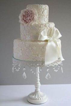 Vintage Lace wedding cake decor. i like this cake platter and the ribbon. ( I could go without the flower)