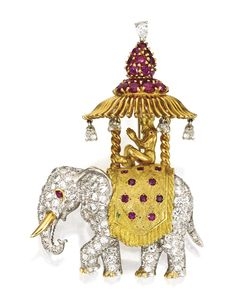 Platinum, 18 Karat Gold, Diamond and Ruby Brooch Designed with a seated male figure atop an elephant adorned with an umbrella, set throughout with numerous round, single-cut and pear-shaped diamonds weighing approximately 4.75 carats, further accented with numerous round rubies.