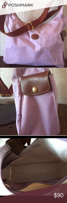 💯 Authentic Longchamp crossbody bag! In excellent condition Longchamp crossbody bag in Lilac color. Very roomy! Adjustable strap. Clean outside and no tears or holes. Inside has a tiny dirt. No smell. Comes from smoke and pet free home. Doesn't come with dustbag. Longchamp Bags Crossbody Bags