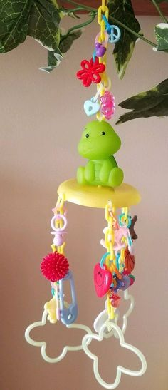 Cute turtle sitting in a base with 3 chains filled with charms. Sugar Glider Toys, Cute Turtles, Parrot, Pet Supplies, Kawaii, Birds, Exercise, Animal, Christmas Ornaments