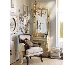 Pottery Barn. white chair. brown embroidered pillow. Old door with mirror and ledge and corbels.