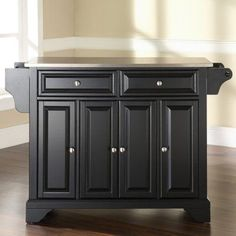 Crosley Furniture Black Composite Base with Composite Wood Top Kitchen Island x x at Lowe's. Constructed of solid hardwood and wood veneers, this buffet server/sideboard cabinet is designed for longevity. The beautiful raised panel doors and Kitchen Island With Granite Top, Granite Tops, Granite Kitchen, Kitchen Islands, Black Granite, Kitchen Cabinets, Granite Countertop, Kitchen Counters, Fixer Upper