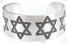 Jewish Star Of David Engraving Pewter Cuff Bracelet Dan Jewelers. $17.97. Dan Jewelers has tens of thousands of positive feedbacks across the internet.. Good value. Does not tarnish. Satisfaction guaranteed.. Hypoallergenic