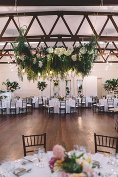 Romantic wedding reception in vintage dining room with floral dance floor canopy   Vanessa Norris Photography