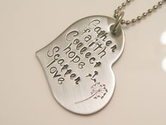 """I have hand stamped this stainless steel 1"""" heart and given it a brushed satin finish. I added the phrase Gather faith, Collect hope, Scatter love. MEMBER - Bee Baubles Jewelry"""