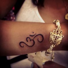 I have an om tattoo (on my hip), but I kinda dig the placement of this one.