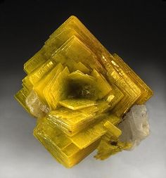 Autunite - A yellow-green mineral that fluoresces under Ultra Violet light and is related to uranium.