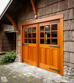 Real Carriage Doors - nice contrast of wood types: rough bark with smooth varnish. Like the stone base too
