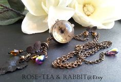 Beautiful Tassel Pendant Necklace with Amber Glass Facet Beads, Purple AB Finished Tear-drops and a Real Working Time Piece! https://www.etsy.com/uk/listing/222124475/beautiful-tassel-pendant-necklace-with by RoseTeaAndRabbit