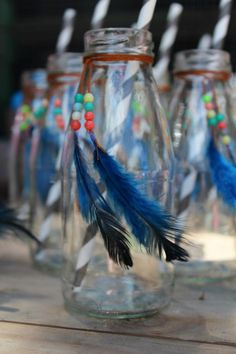 Mini milk bottles & paper straws for our Cowboys & Indians party- oh wowzers!!! How cute!!! I know Maggie would love making something like this for party favors!!!