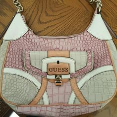 Brand New Guess Purse Plastic is still intact to prevent scratching. Is NOT sold although it is listed on my account as it is (I was out of town for a few days so the buyer canceled the order). Great condition. Super cute print on the inside Guess Bags Shoulder Bags